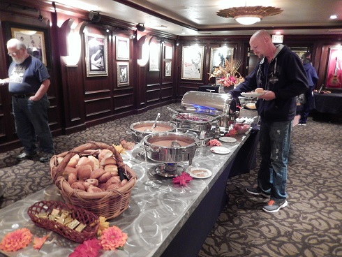 Corn bread dressing, cranberry, rolls and butter were at the end of the buffet near the turkey carving station.