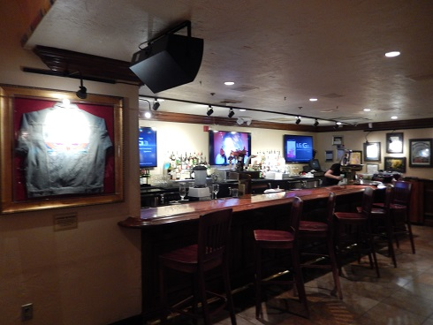 The bar area at Hard Rock Cafe has several televisions for sports fan to watch sporting events.