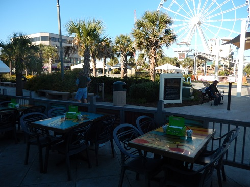 Moe Moons outdoor boardwalk seating live entertainment