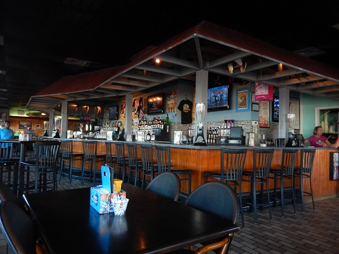 Inside Moe Moons Bar and Grill is a beach house look and feel