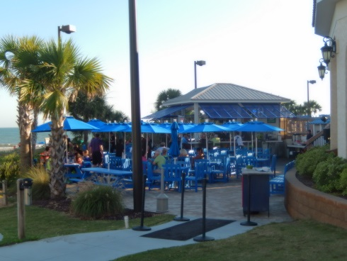 Outside of Banditos Restaurant seating area with an ocean view