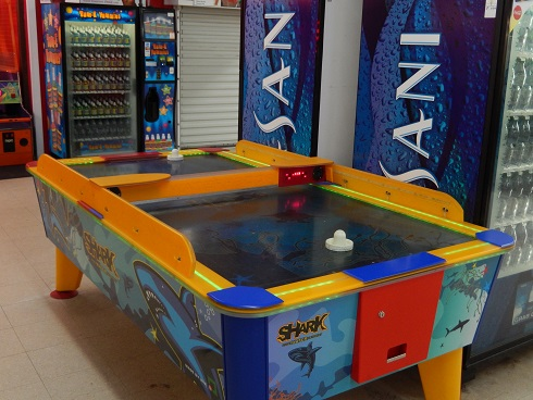 The Shark Ice Hockey is next to water and soda vending machines