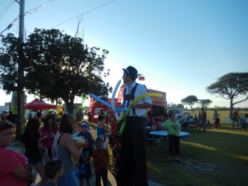 Myrtle Beach Octoberfest On stilts making balloons for Kids during Octoberfest