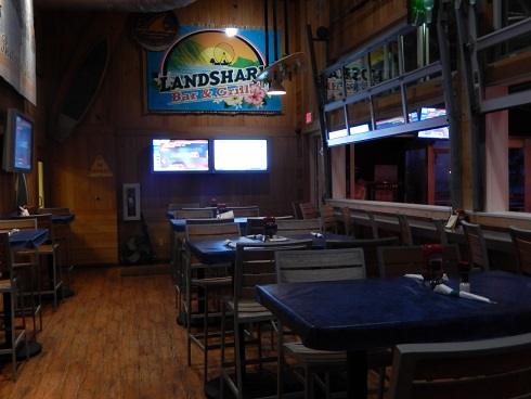 Inside the Landshark Bar & Grill beside the bar