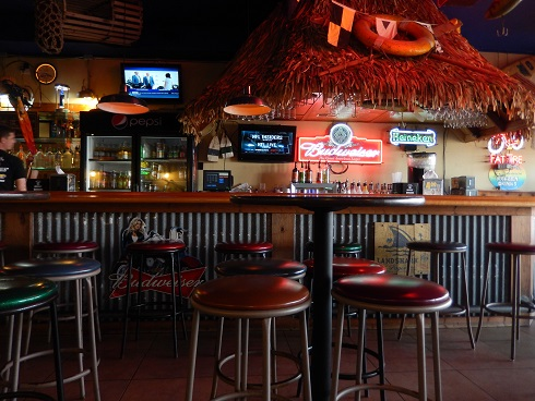 Bar seating at Dirty Dons fills quickly during happy hour, events and games.